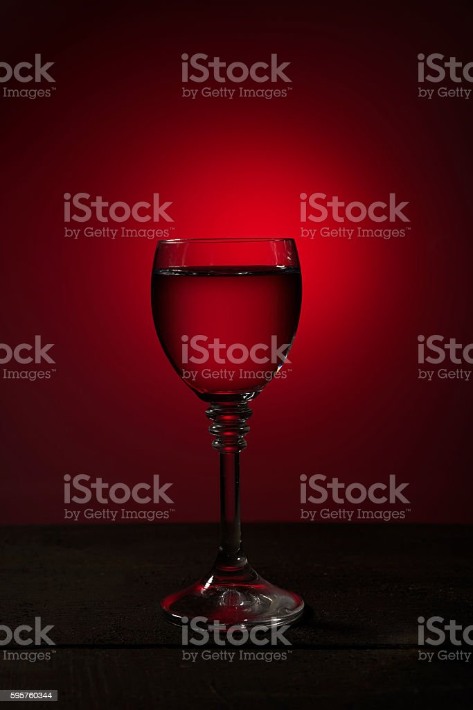 glass of red wine on a dark background stock photo