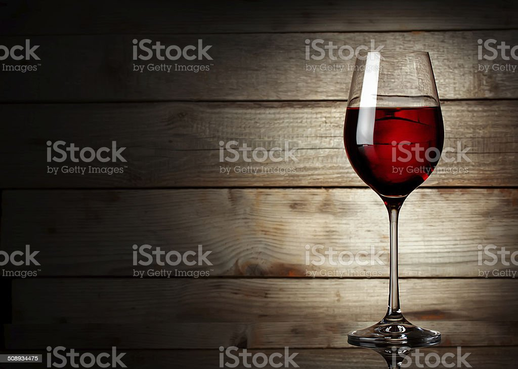 Glass of red wine on a young stock photo
