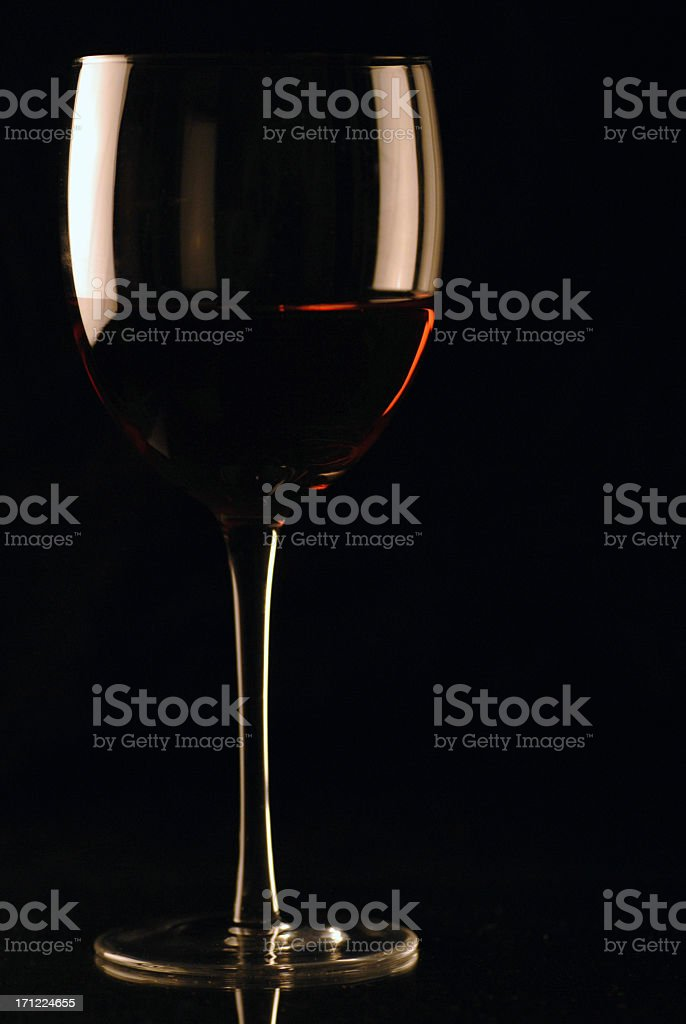 Glass of red wine on black background royalty-free stock photo