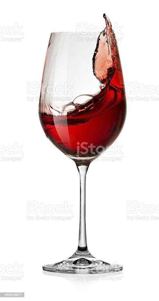 Glass of red wine splash over white background stock photo