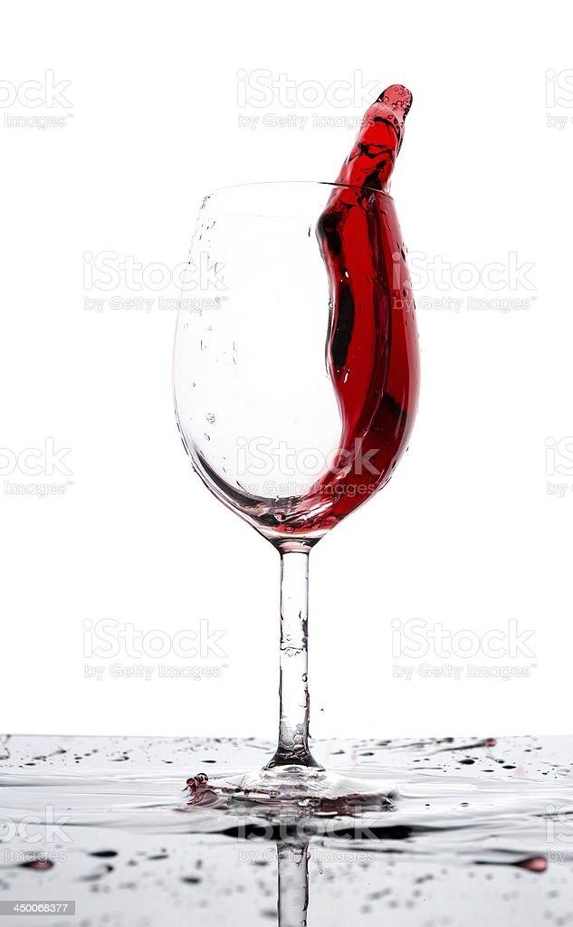 Glass of red wine splash royalty-free stock photo