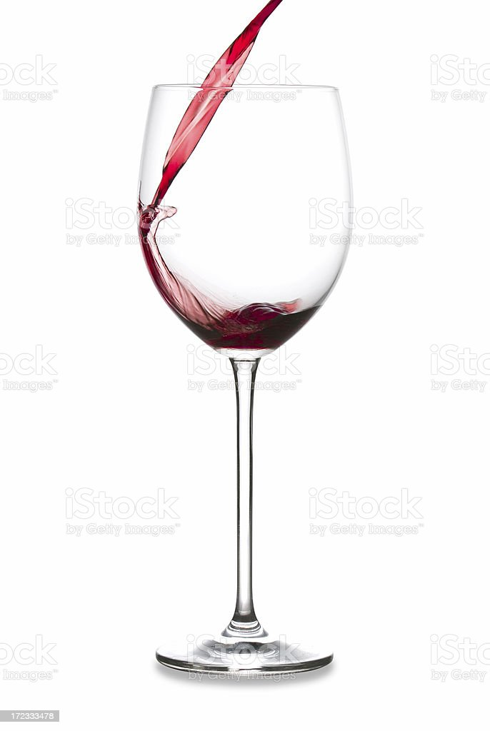 glass of red wine which is poured in splashing royalty-free stock photo
