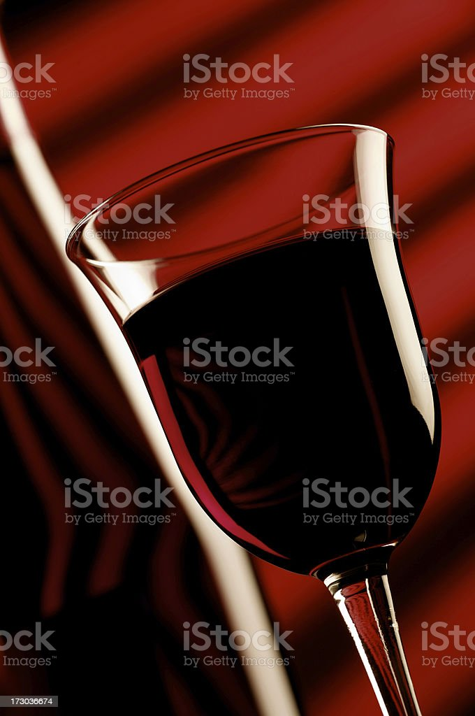 glass of red wine with bottle royalty-free stock photo