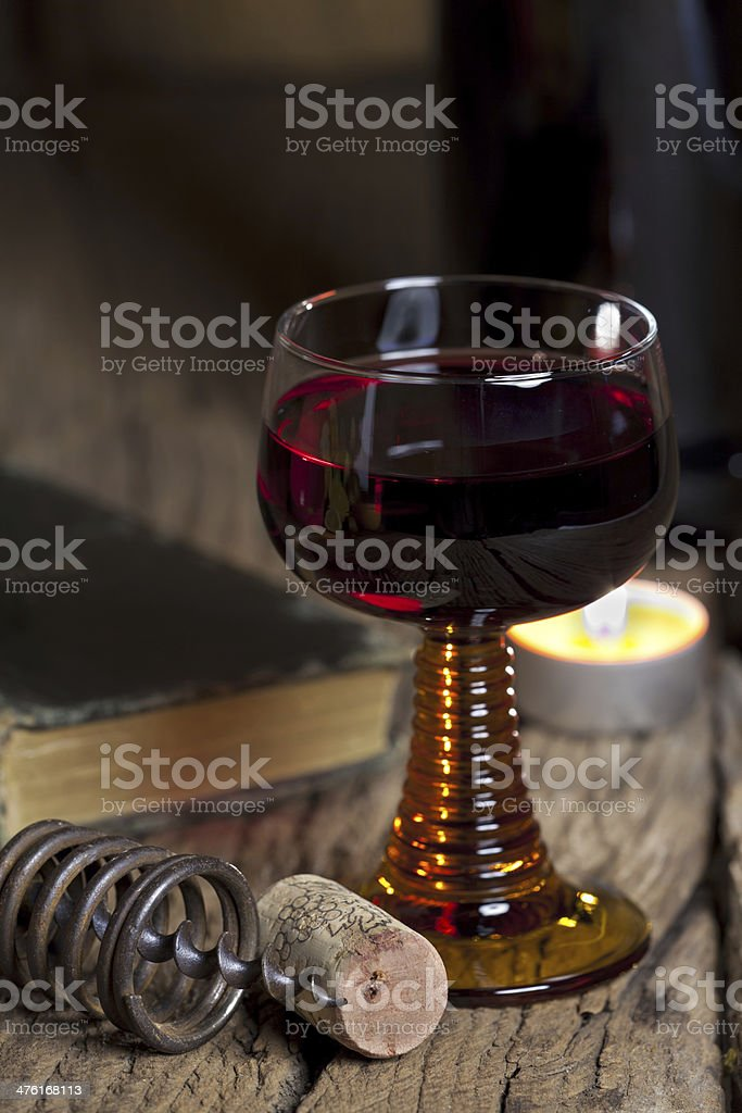 Glass of red wine with candle royalty-free stock photo