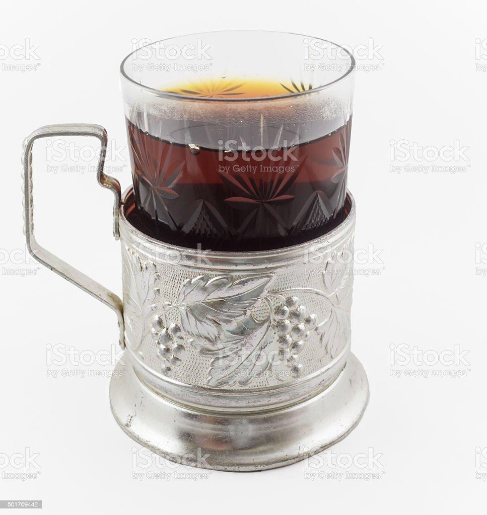 Glass of russian tea in vintage glass holder podstakannik stock photo