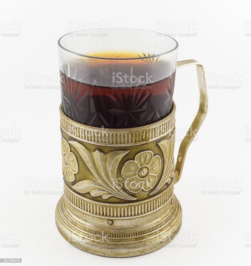 Glass of russian tea in vintage glass-holder podstakannik stock photo