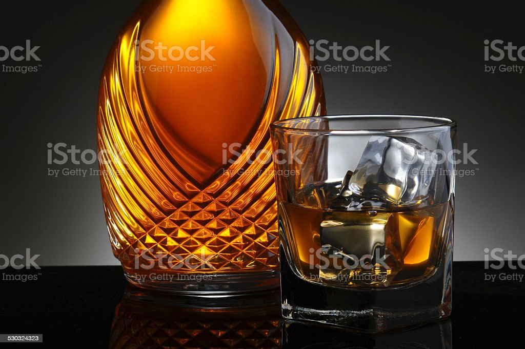 Glass of Scotch and Elegant Decanter stock photo