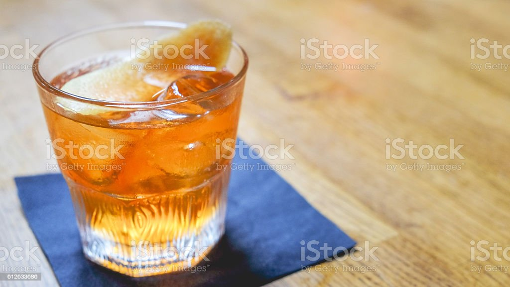 Glass of scotch on table stock photo