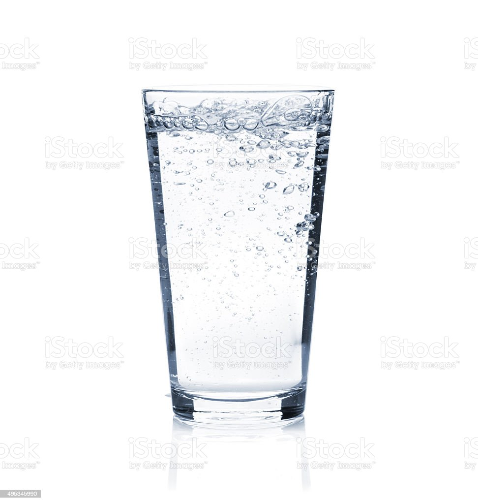 Glass of sparkling water stock photo