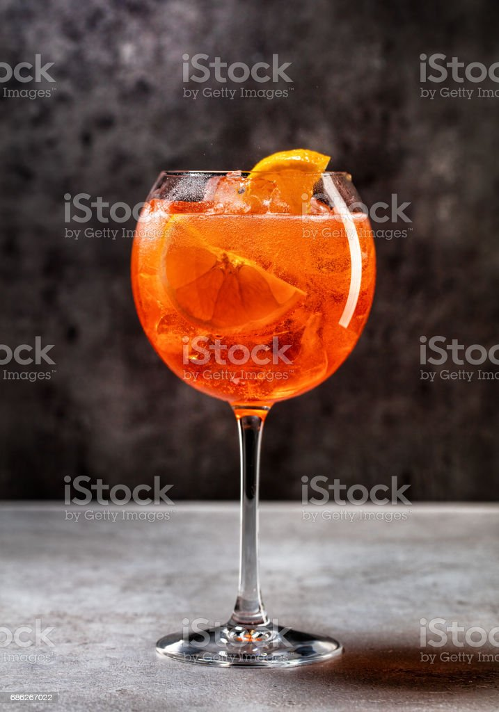 glass of aperol spritz cocktail stock photo