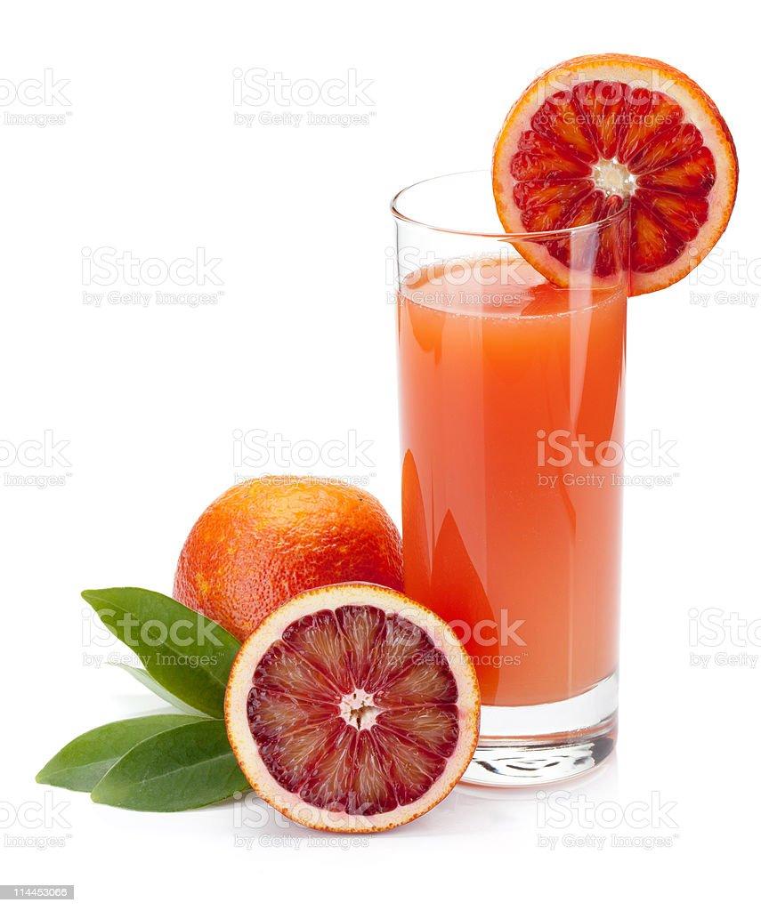 Glass of squeezed blood orange juice stock photo