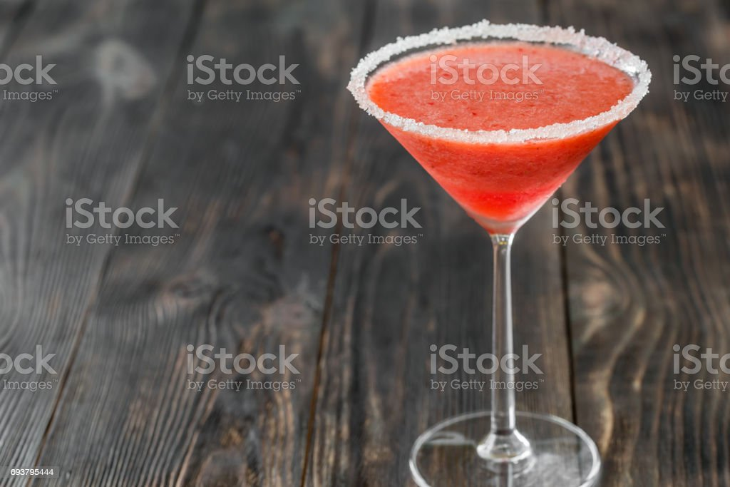 Glass of strawberry margarita cocktail stock photo