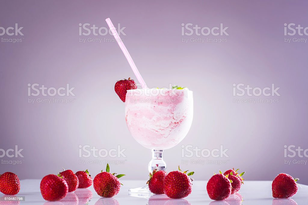 Glass of strawberry shake with fresh strawberries stock photo