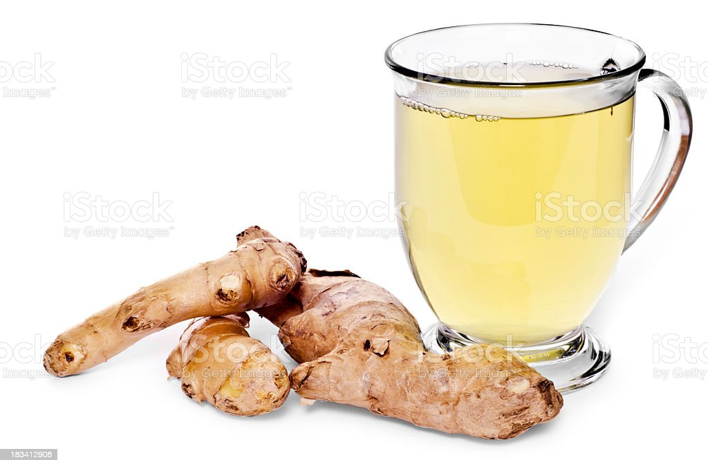 Glass of tea and ginger root on white background stock photo