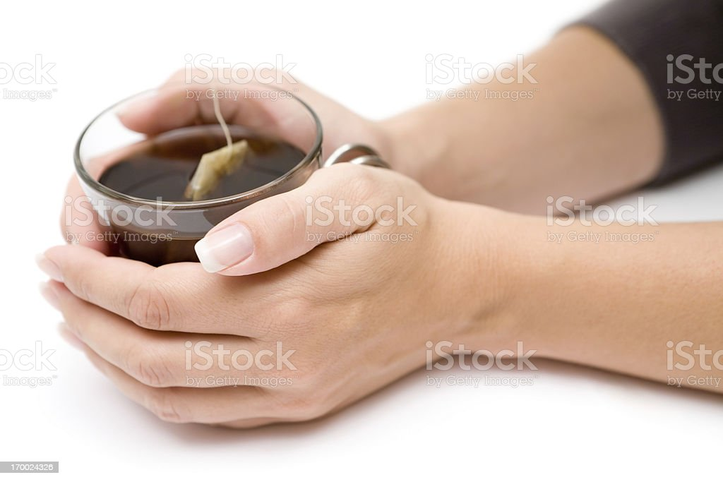Glass of Tea in Her Hands royalty-free stock photo