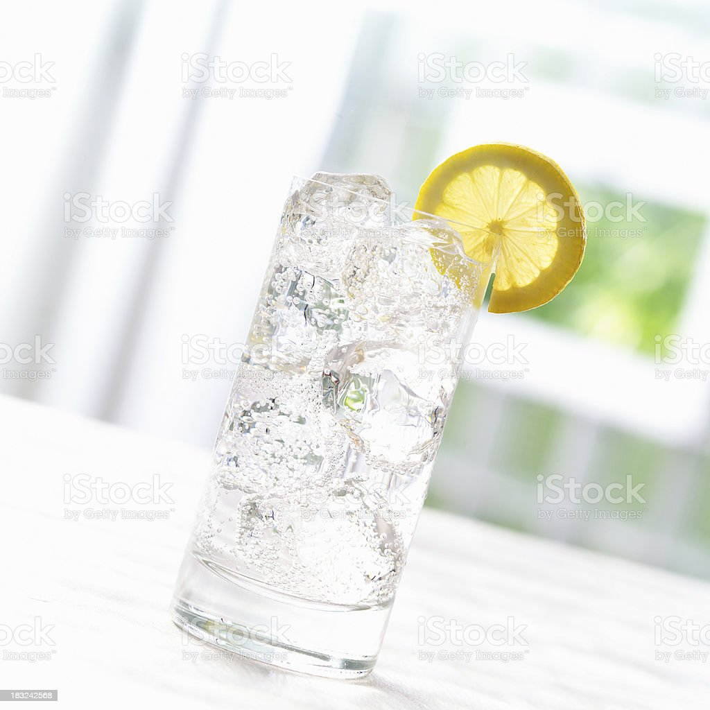 Glass of Tonic Water with Lemon Slice royalty-free stock photo