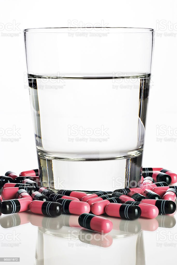 Glass of water and diet pills royalty-free stock photo