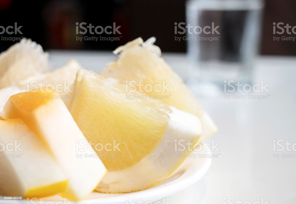 glass of water and fruit  on table stock photo