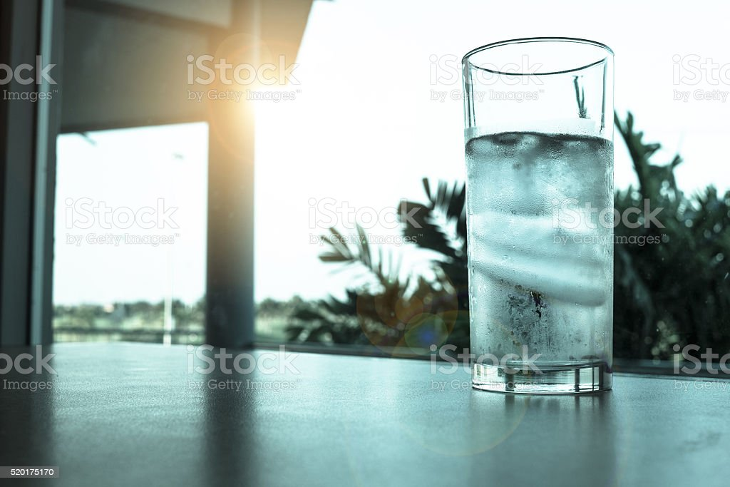 Glass of water and ice stock photo