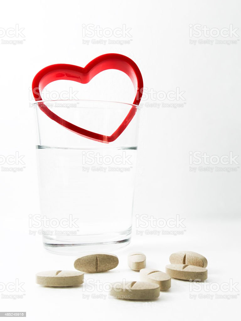 Glass of water and Vitamin supplements. royalty-free stock photo
