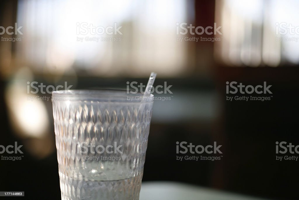 Glass of water in plastic drinking cup with straw royalty-free stock photo