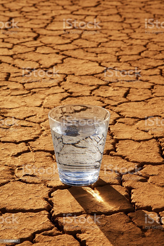 Glass of Water in the Desert stock photo