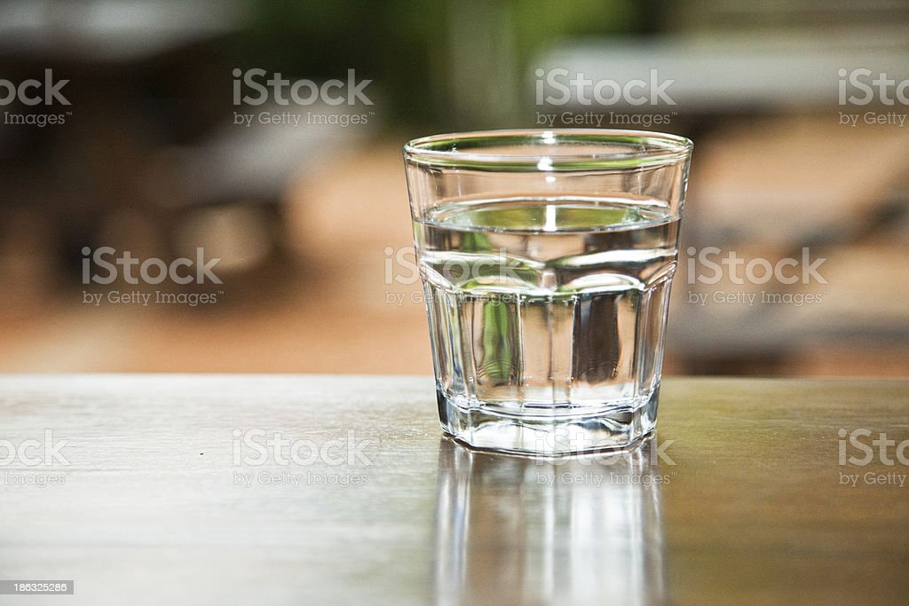 Glass of Water on a Table royalty-free stock photo