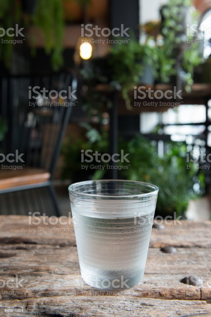 glass of water on a table stock photo