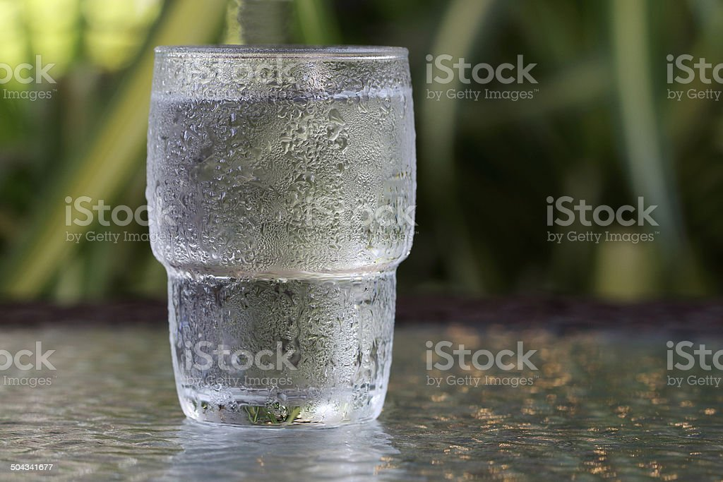 glass of water on table stock photo
