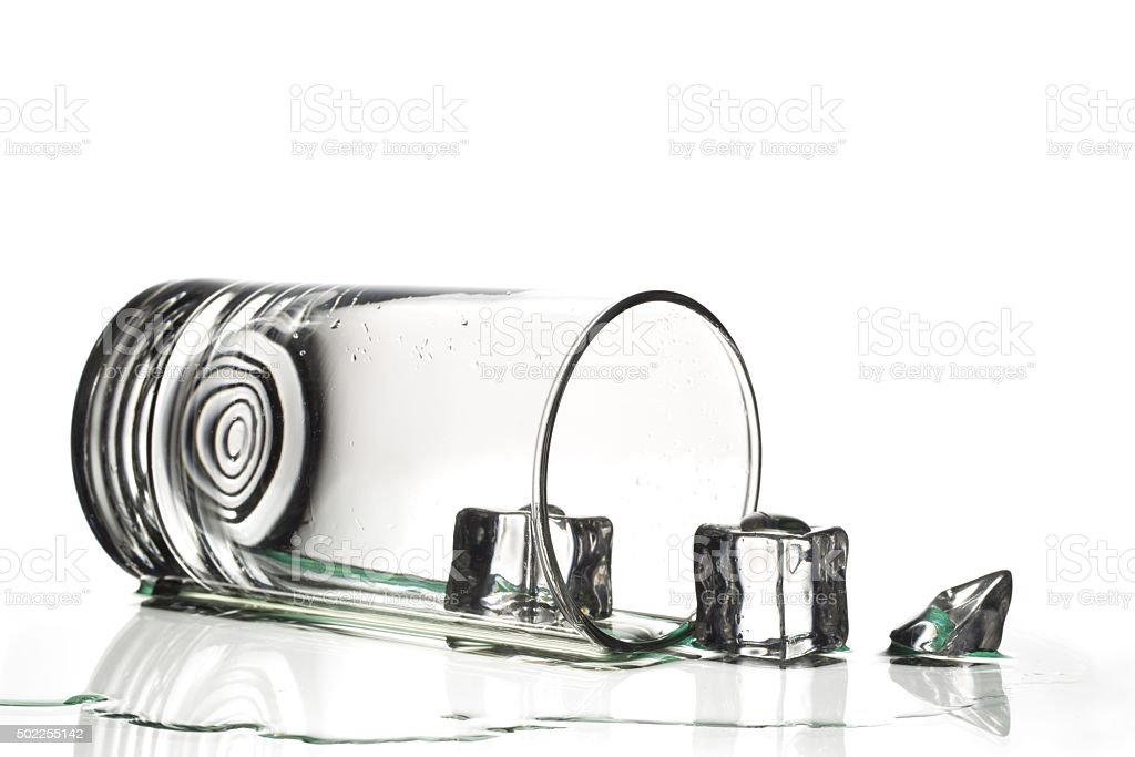 glass of water on white surface stock photo