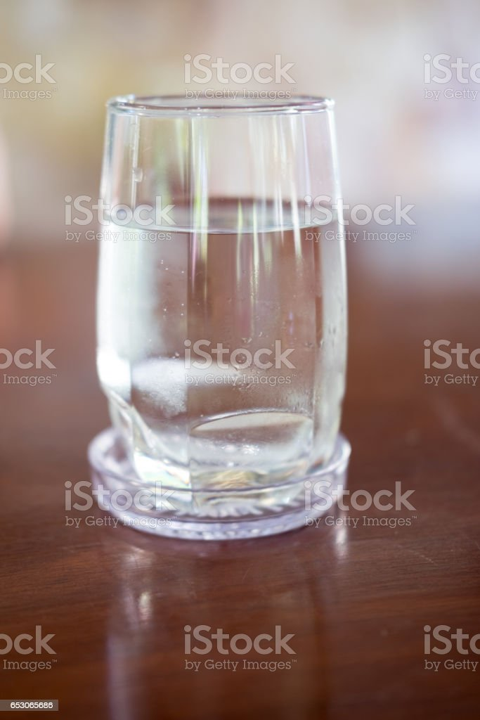 glass of water on wood background stock photo
