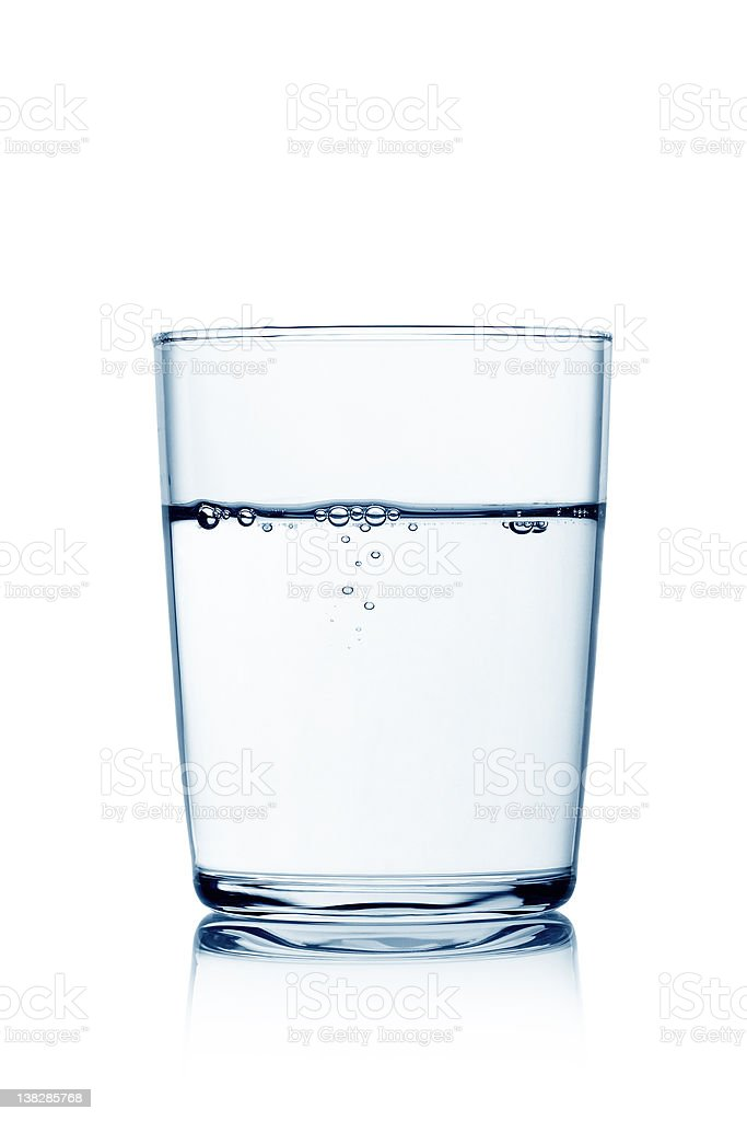 Glass of water with bubbles stock photo