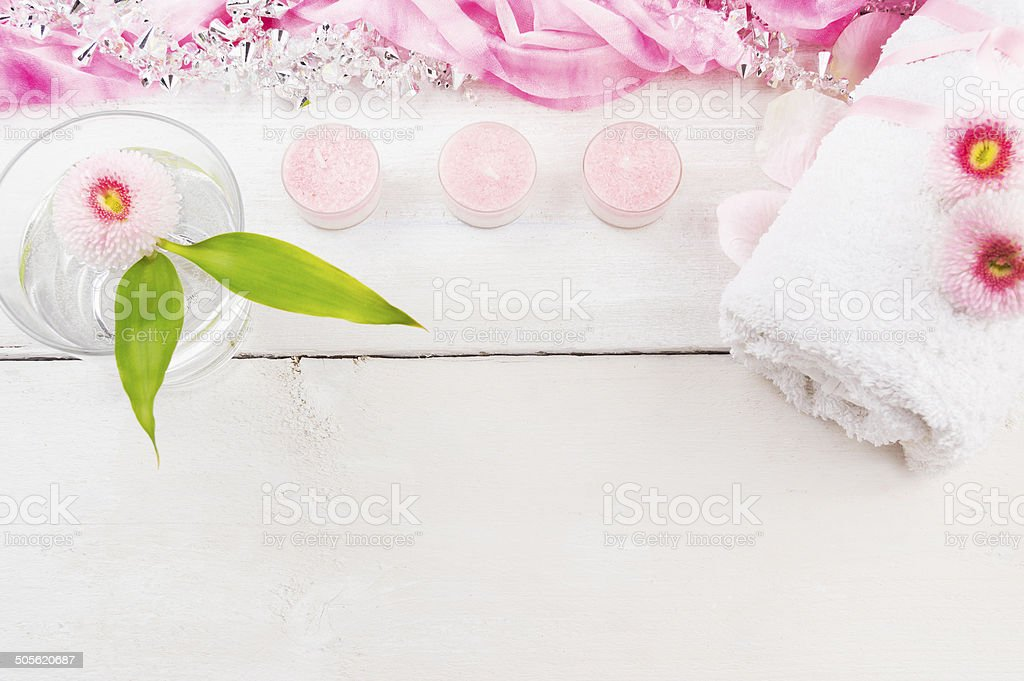 glass of water with flower, pink candles and towel ,spa royalty-free stock photo