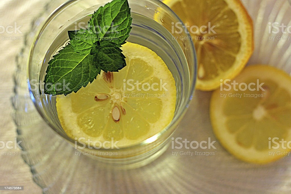 Glass of water with lemon and mint royalty-free stock photo