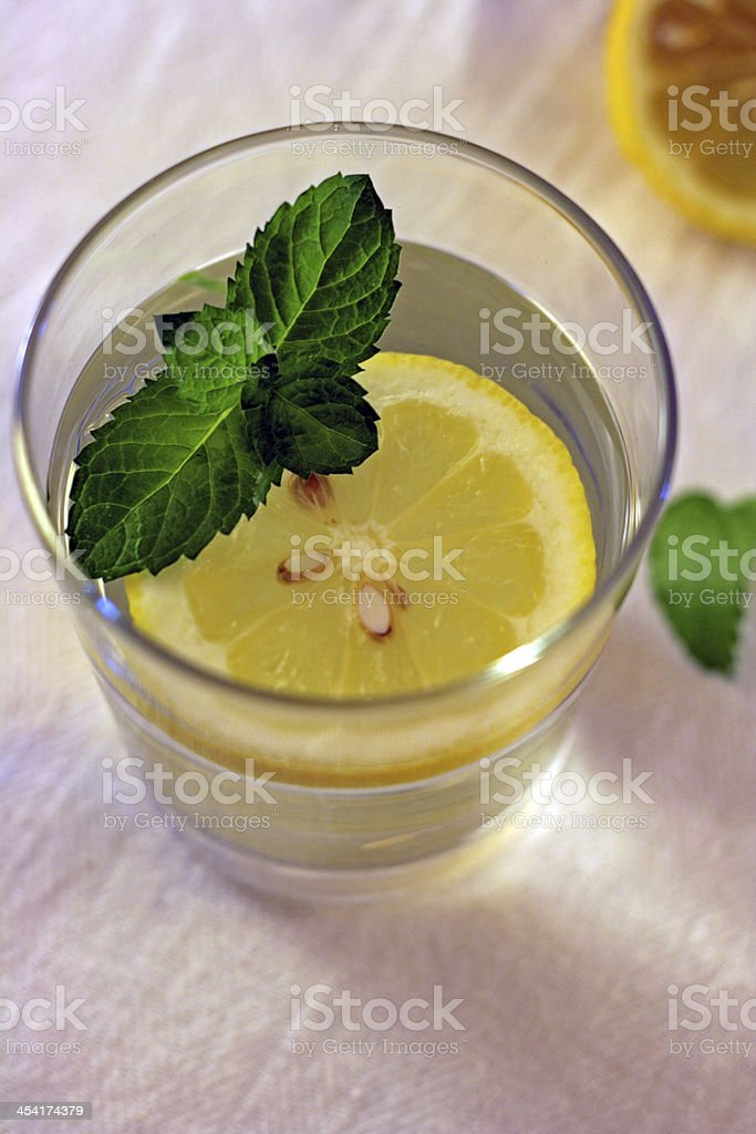 Glass of water with lemon and mint stock photo