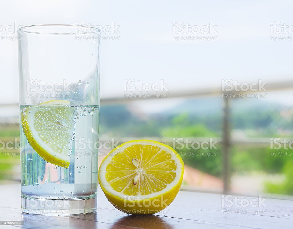 Glass of water with lemon stock photo