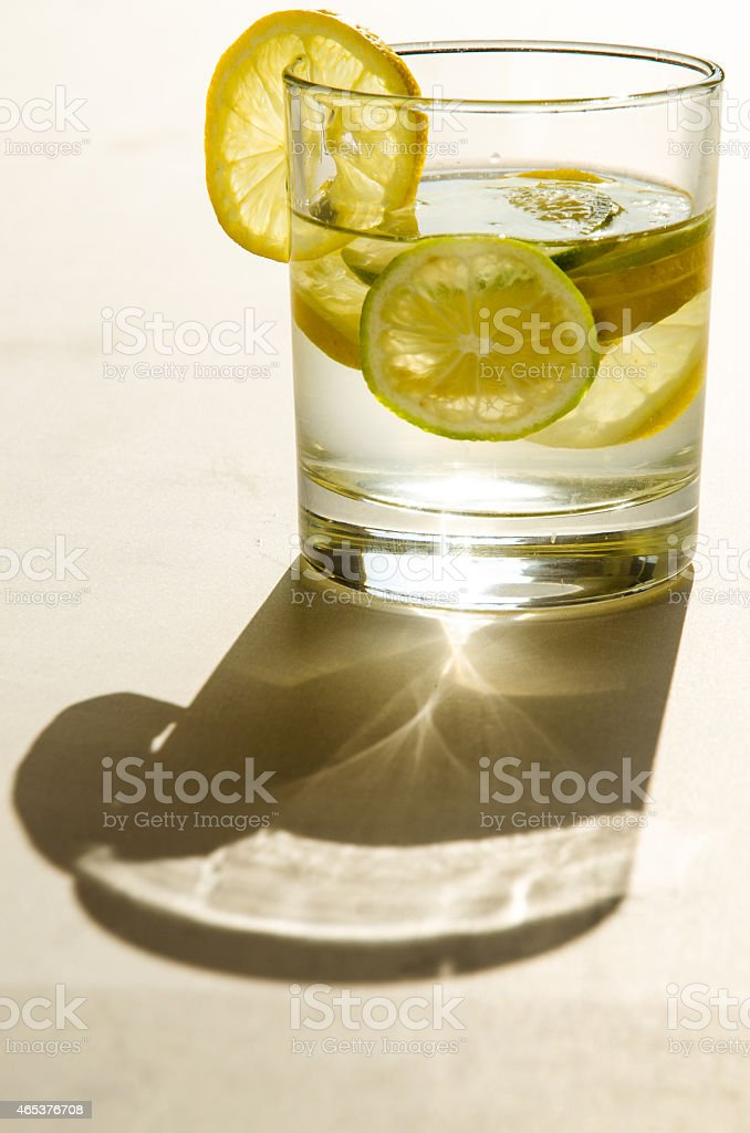 glass of water with lemon slice stock photo
