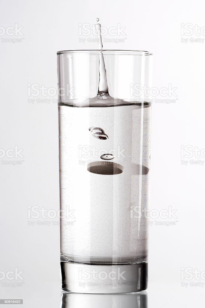 Glass of water with pill royalty-free stock photo