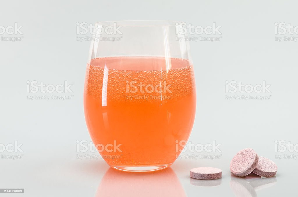 Glass of water with vitamin pills stock photo