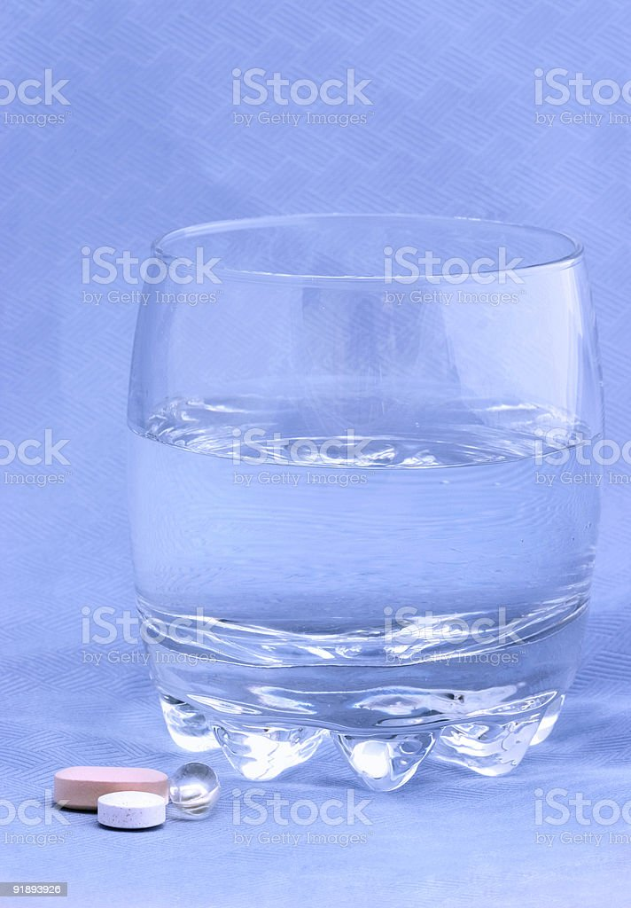 Glass of water with vitamins royalty-free stock photo