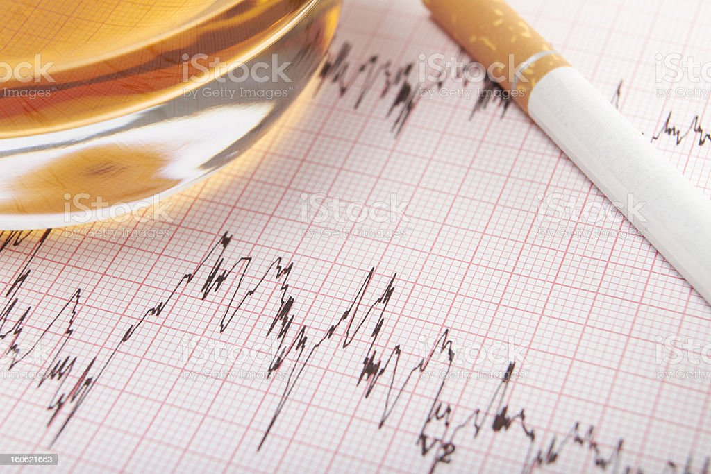 Glass Of Whiskey And Cigarette On ECG Printout royalty-free stock photo
