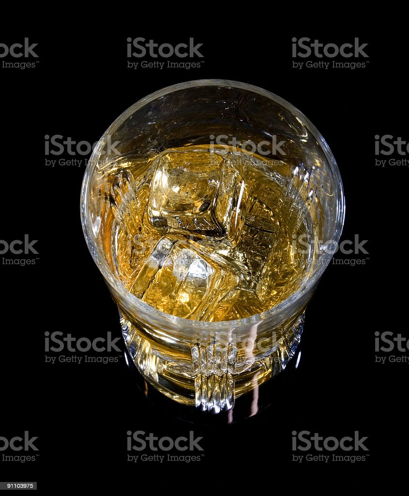 Glass of whiskey and ice stock photo