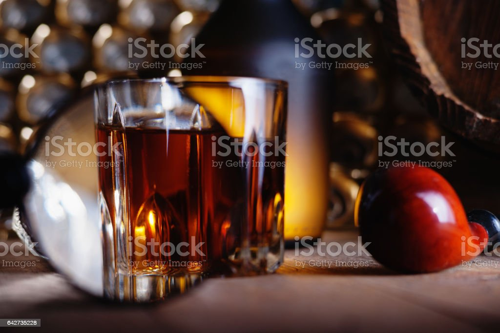 Glass of whiskey, magnifying glass and smooking pipe stock photo
