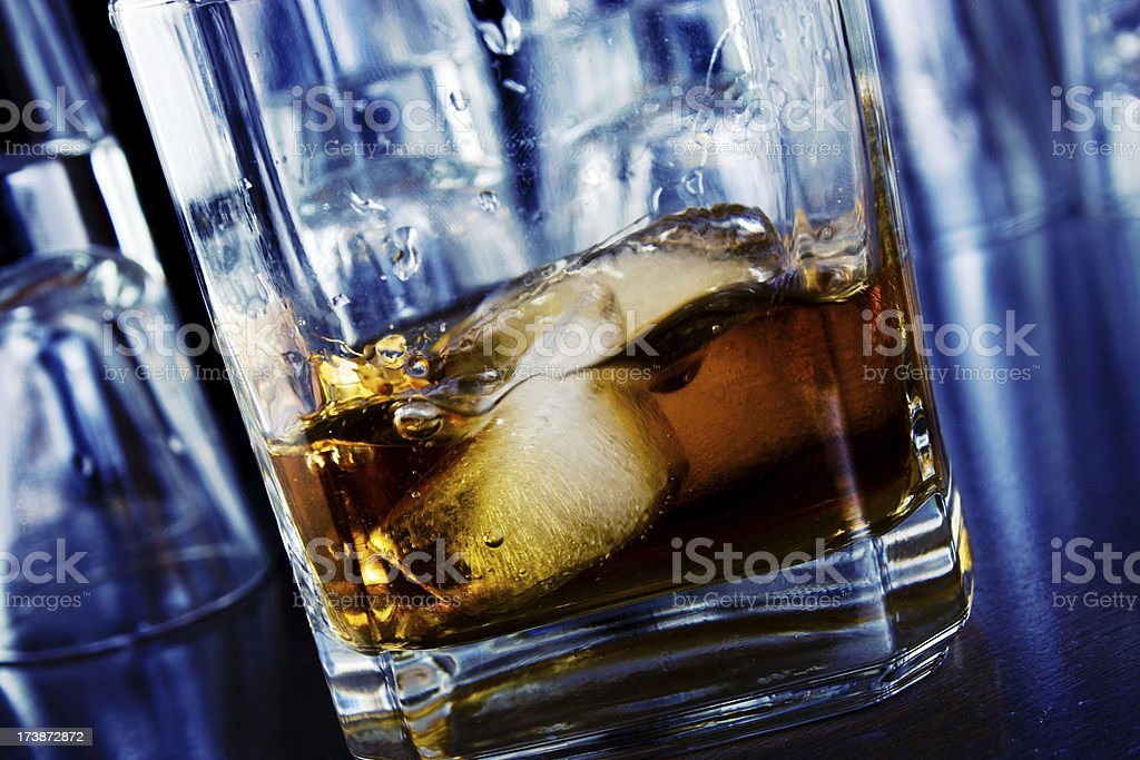 Glass of whiskey on a bar royalty-free stock photo