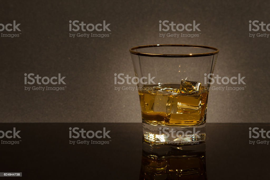 glass of whiskey on a glass table stock photo