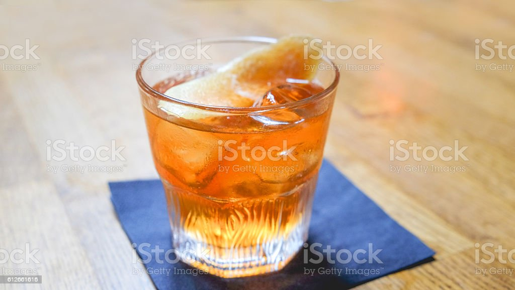 Glass of whiskey on bar stock photo