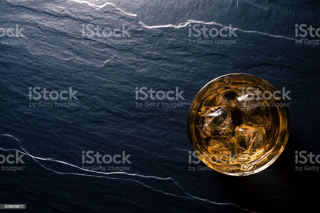 Glass of whiskey on dark table stock photo
