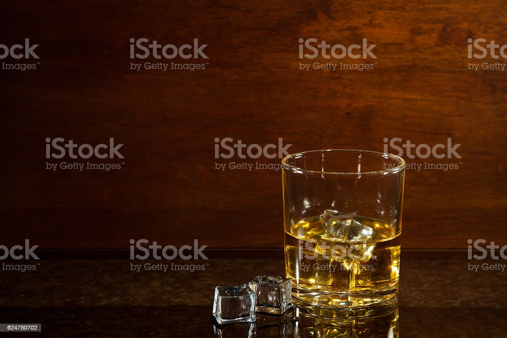 glass of whiskey on glass table stock photo