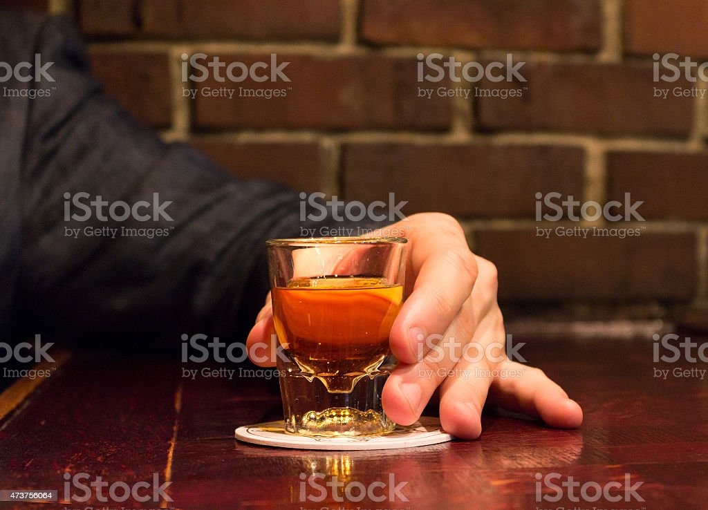 Glass of whiskey on the bar counter stock photo