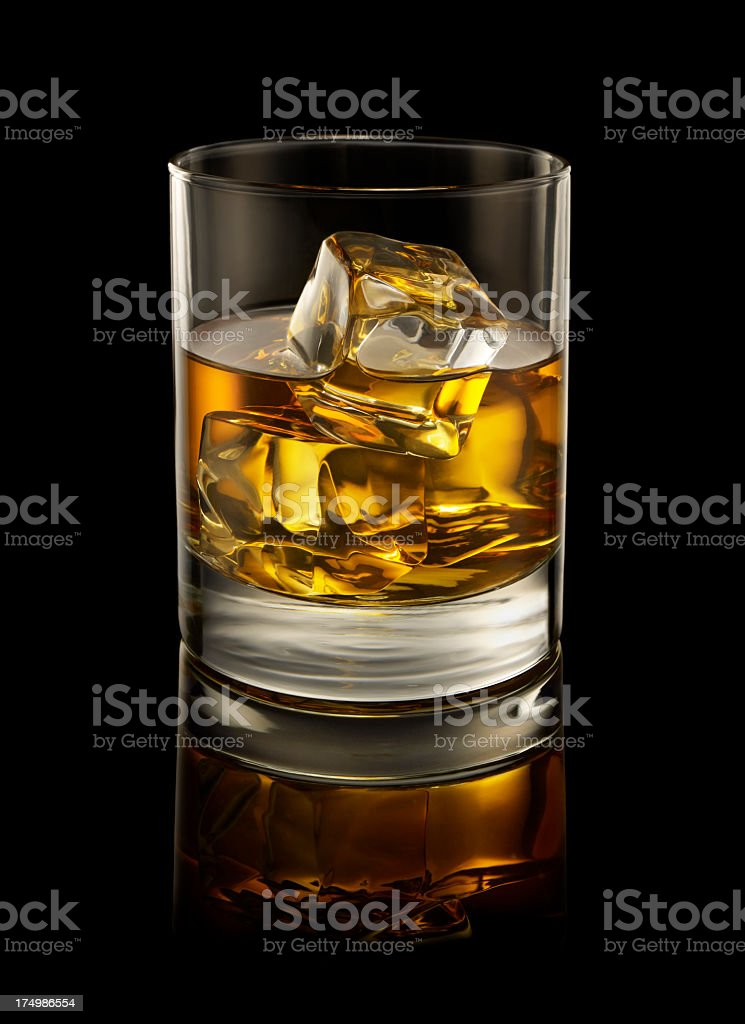 A glass of Whiskey on the rocks stock photo